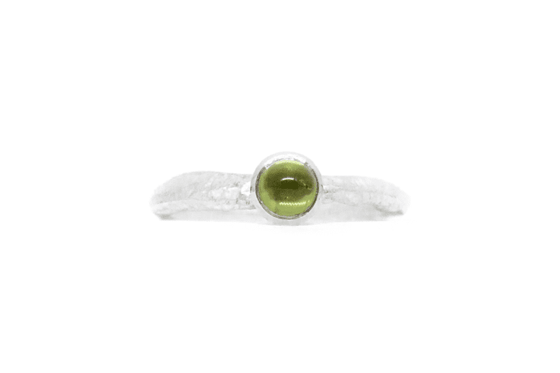 Wabi Sabi silver ring with a peridot