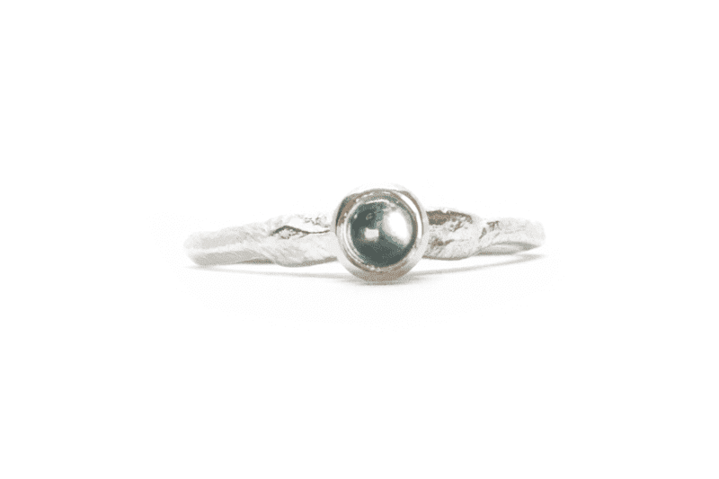Wabi Sabi silver ring with a topaz