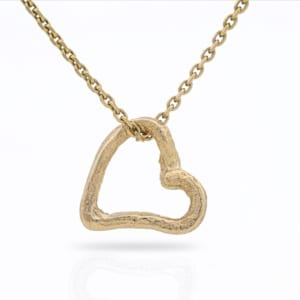 Wabi Sabi Mingle heart in gold - a small open heart pendant